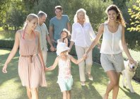 Happy family walking together in backyard — Stock Photo