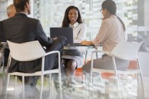 Business people talking in meeting at modern office building — Stock Photo