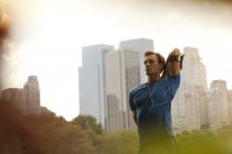 Runner stretching in urban park before  work out — Stock Photo
