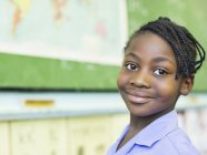 African american student smiling in class — Stock Photo