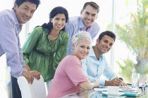 Business people smiling at modern office — Stock Photo