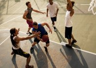 From above view of men playing basketball on court — Stock Photo