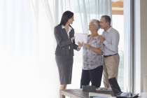 Financial advisor talking to couple in office — Stock Photo