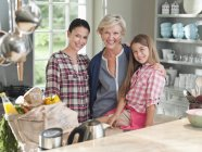 Three generations of women in kitchen — Stock Photo