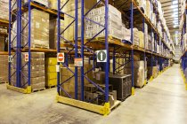Aisles of boxes in warehouse — Stock Photo