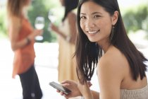 Young attractive Smiling woman using cell phone — Stock Photo