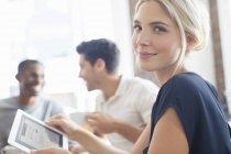 Businesswoman using digital tablet at meeting — Stockfoto