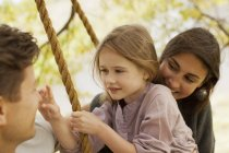 Close up of family on swing — Stock Photo