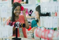 Women shopping together in store — Stock Photo