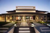 Luxury house and patio illuminated at night — Stock Photo