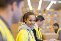 Worker smiling in warehouse — Stock Photo