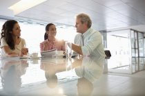 Business people talking in lobby at modern office — Stockfoto