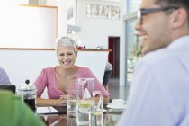 Business people smiling in meeting at modern office — Stockfoto