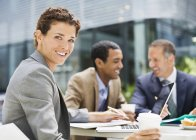 Happy businesswoman smiling in meeting outdoors — Stock Photo