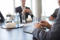 Close up of businessman hands in meeting at modern office — Stock Photo