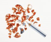 Eyeliner pencil and shavings on white surface — Stock Photo