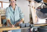 Skillful caucasian woman working in workshop — Stock Photo