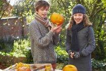 Children carving pumpkins together — Stock Photo