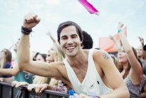 Enthusiastic man cheering at music festival — Stock Photo