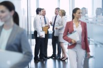 Business people talking in hallway at modern office — Stock Photo