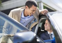 Two successful businessmen talking in car — Stock Photo