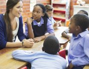 African american students and teacher talking in class — Stock Photo