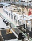 Bottles on conveyor belt in factory — Stock Photo