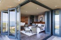 Doors on patio open to modern bedroom — Stock Photo