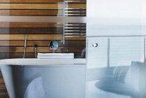 Bathtub and glass door in modern bathroom — Stock Photo