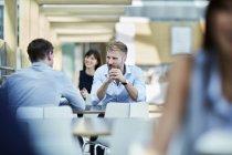 Businessmen talking at office interior — Stock Photo