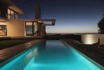 Modern pool illuminated at night — Stock Photo