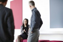Successful adult business people talking in lobby — Stock Photo
