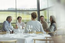 Friends at winery dining room table — Stock Photo