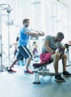 Men working out at gym — Stock Photo