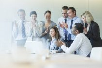 Business people cheering in meeting — Stock Photo
