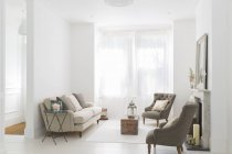 Sofa and armchairs in living room — Stock Photo