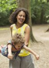 Playful mother flying son — Stock Photo