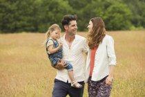 Family walking in rural field — Stock Photo