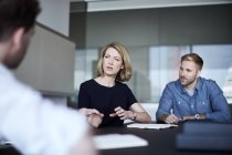 Businesswoman talking in meeting — Stock Photo
