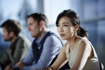 Successful adult business people sitting in meeting — Stock Photo