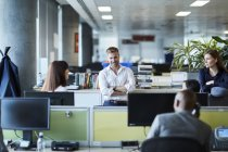 Business people talking in office cubicle — Stock Photo