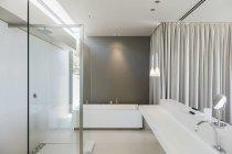 Sink, bathtub and shower in modern bathroom interior — Stock Photo