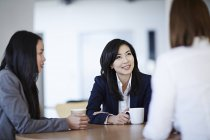 Successful adult business people talking in meeting — Stock Photo