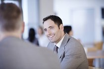 Successful adult business people talking in office — Stock Photo