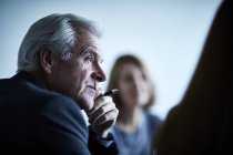 Attentive senior businessman listening in meeting — Stock Photo