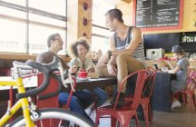 Friends hanging out talking in cafe — Stock Photo