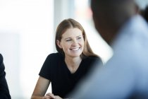 Smiling businesswoman in meeting — Stock Photo
