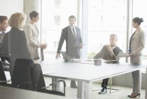 Business people talking in conference room — Stock Photo