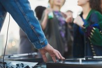 DJ spinning records at party — Stock Photo