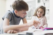 Brother helping sister with homework — Stock Photo